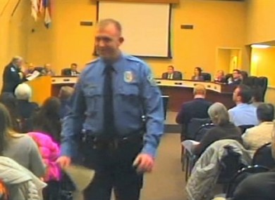 In this February, 2014 file image from video released by the City of Ferguson, Mo., officer Darren Wilson attends a city council meeting in Ferguson.