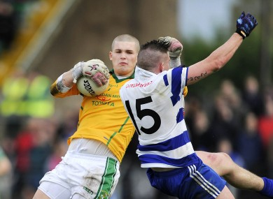 Jack Hannigan clashes with Jake Regan during today's game.