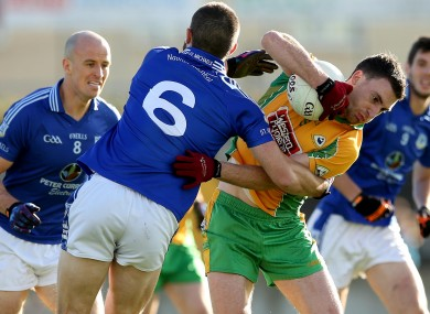 Michael's Jamie Downes tackles Ronan Steede of Corofin.