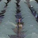 A child walks under the umbrellas on display over Cheonggye stream during a campaign to raise money donation to help underprivileged children in Seoul, South Korea.<span class=