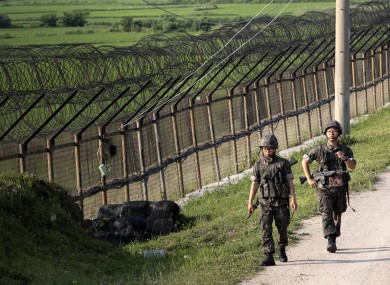 South Korean army soldiers patrol through the military wire fence in Paju, near the border with North Korea.