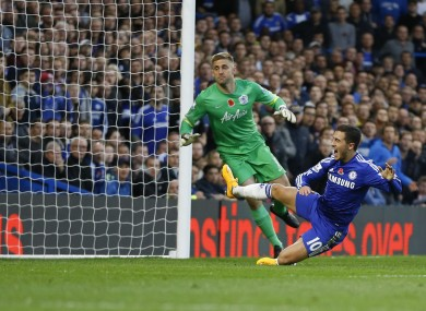 Hazard won and scored the winning penalty for The Blues.