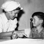 Ilse Hess, the wife of Rudolph Hess, No. 2 Nazi, with her son Wolf, aged 7. Ilse Hess vistied her husband at the Nuremberg jail.<span class=