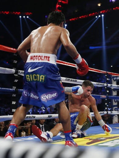 Pacquiao knocks down challenger SIX times in latest defence – calls out Mayweather again