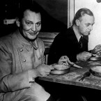 The former Reichsmarschall of Nazi Germany, Hermann Goering, smiles for the camera while eating from a mess tin during the post-war Nuremberg Trials. <span class=