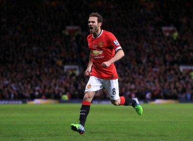 Manchester United's Juan Mata celebrates scoring his side's opening goal.