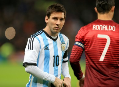 Argentina's Lionel Messi (left) with Portugal's Cristiano Ronaldo (right) before the match.
