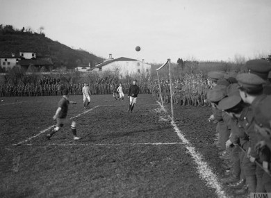 The ball is crossed into the box as British Army troops play in the final of the Fanshawe Cup in Trissino, Italy.