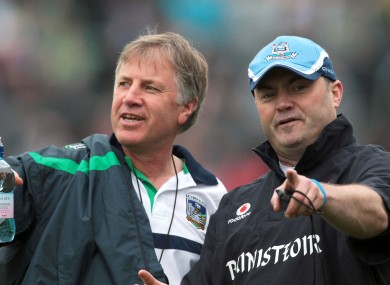 Anthony Daly talks to former Limerick boss Donal O'Grady in 2011.