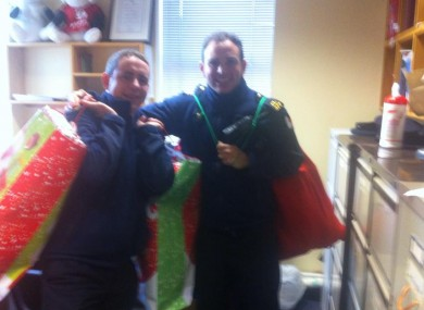 Gardaí take delivery of presents for the two girls.