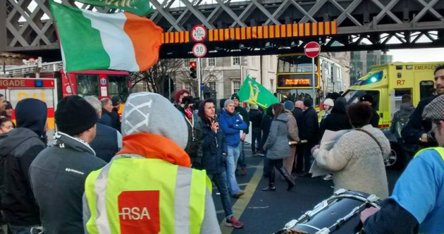 Pedestrian rushed to hospital after car crashes into group of protesters