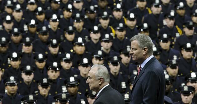 New York mayor booed at police graduation as tensions increase