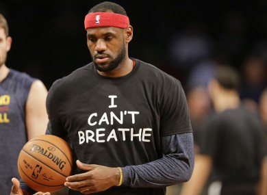 Lebron James warms up wearing an 'I Can't Breathe' t-shirt. The shirts protest a grand jury decision not to indict an NYPD officer in the death of Eric Garner.