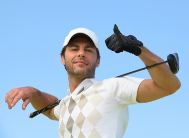 File photo of a rich man playing golf.