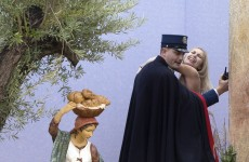 A topless woman tried to steal the Baby Jesus out of the Vatican's crib