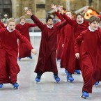 The Boy Choristers of Winchester Cathedral Choir skate on the Cathedral's ice rink.<span class=