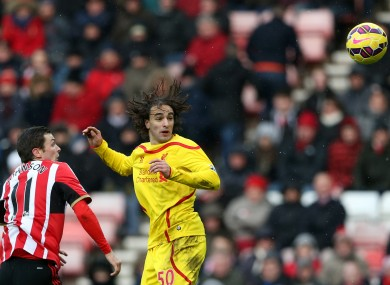 Liverpool's Lazar Markovic, right, vies for the ball with Sunderland's Adam Johnson.