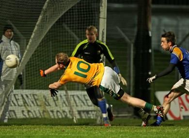 Meath's Sean Tobin scores a goal past Longford goalkeeper Paddy Collum.
