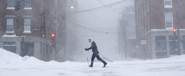 Lisetta Shah cross-country skis on Commercial Street in Portland, Maine, Tuesday, during a winter storm