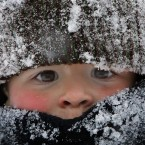 Will Annicchiarico is bundled up as he plays in the snow following a snowstorm in Concord, NH. <span class=