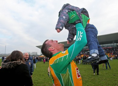 Corofin's Gary Delaney celebrates with his daughter Kaya after the game.