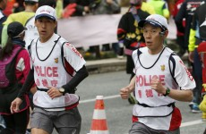 Running Police ensure Tokyo Marathon goes off peacefully amid security fears