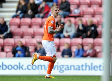Keogh celebrates a goal during his time with Blackpool.