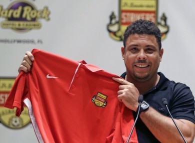 Ronaldo posing with a Fort Lauderdale Strikers jersey last month.