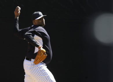 Sabathia throws in the bullpen during the first day of workouts.