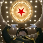 A military band conductor leads during the opening session of the National People's Congress at the Great Hall of the People in Beijing.<span class=