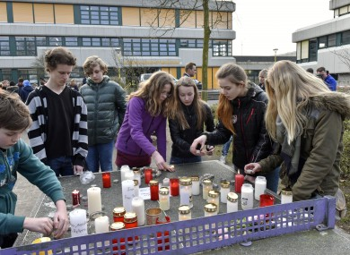 Students put candles on a table tennis table in front of the Joseph-Koenig Gymnasium in Haltern