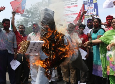 A effigy representing rapists is burned in Dehli. (File)