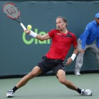 Alexandr Dolgopolov, of Ukraine, returns the ball to Tommy Robredo, of Spain, at the Miami Open tennis tournament in Key Biscayne. (AP Photo/Joel Auerbach)<span class=