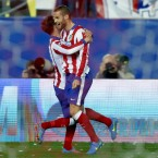 Atletico's scorer Mario Suarez, right, and his teammate Jesus Gamez, left, celebrate their side's first goal during the Champions League round of sixteen second leg soccer match between Atletico de Madrid and Bayer 04 Leverkusen at the Vicente Calderon stadium in Madrid, Spain. (AP Photo/Daniel Ochoa de Olza)<span class=