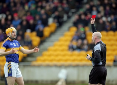 Referee John Keenan shows a red a card to Seamus Callanan of Tipperary.