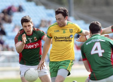 Donegal's Martin McElhinney with Mayo's Lee Keegan.