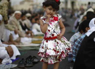 File Photo: A Yemeni girl poses for a photograph as she attends the Eid al-Fitr prayer with her father, in Sanaa, Yemen