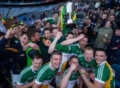 Offaly players celebrate their victory.