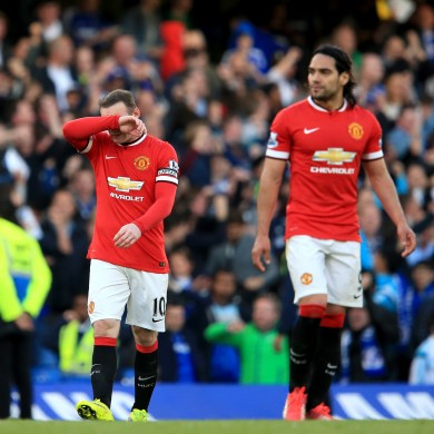 Manchester United's Wayne Rooney (left) and Radamel Falcao (right) dejected.