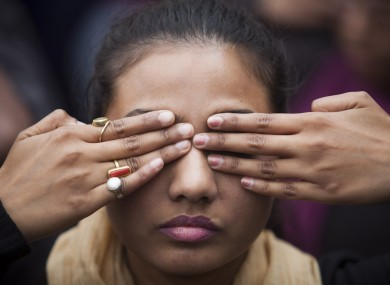 An Indian girl participates in a street play to create awareness on violence against women