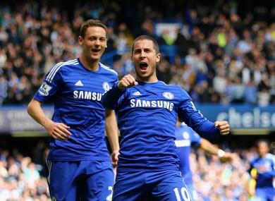 Chelsea attacking midfielder Eden Hazard celebrates with team-mate Nemanja Matic