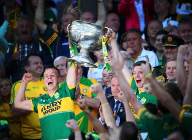 Fionn Fitzgerald and Kieran O'Leary lift the Sam Maguire.