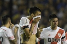 Boca Juniors versus River Plate suspended after apparent tear gas attack