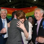 John Lyons TD and Tanaiste Joan Burton hug each other as people around them celebrate the result at the Marriage Equality Referdendum Count Centre in RDS this afternoon.<span class=