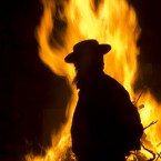 An ultra-Orthodox Jewish man stands next a bonfire in Jerusalem during the Lag Ba'Omer holiday, marking the end of a plague said to have decimated Jews during the Roman times. <span class=