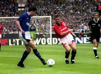 Everton's Gary Ablett plays the ball under pressure from Manchester United's Roy Keane.