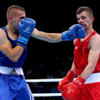 Adam Nolan feels the full force of a left hook from opponent Alban Beqiri at the European Games in Baku.<span class=