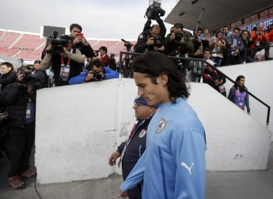 Uruguay's Edinson Cavani enters the field for training during the Copa America tournament at the National Stadium in Santiago, Chile earlier.