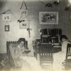 Photos and momentos kept it homey in this room in 1899.<span class=