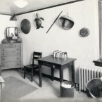 This single dorm from the 1930s appears to be filled with souvenirs from a student's travels. <span class=